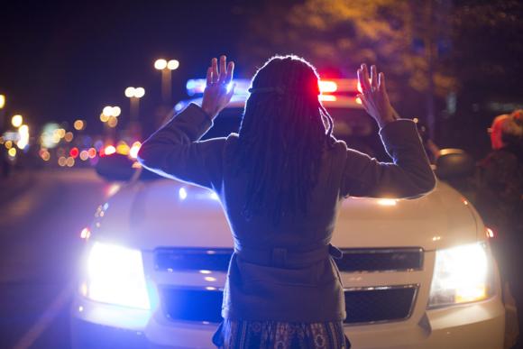 Ferguson protestor, photo by Josh Sinn