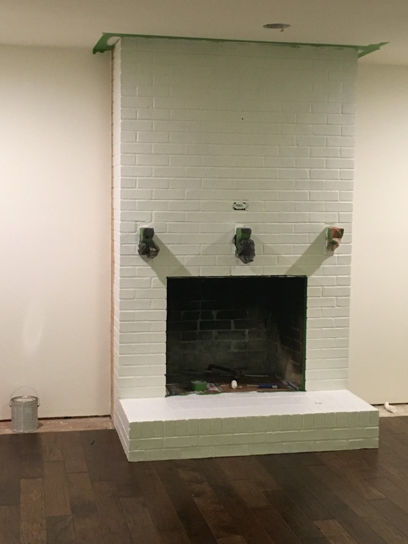 Brick fireplace primed
