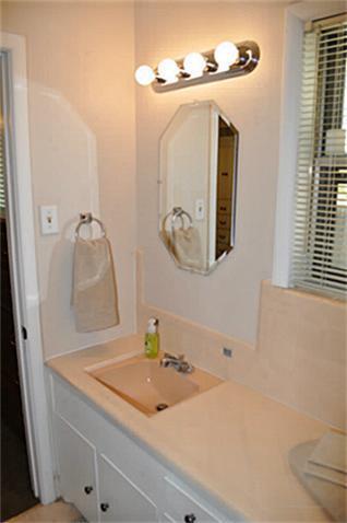 vanity and sink in master bathroom