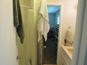 two doors in narrow bathroom